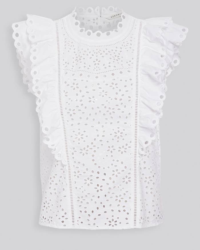 a white eyelet tank top with ruffled sleeves and collar
