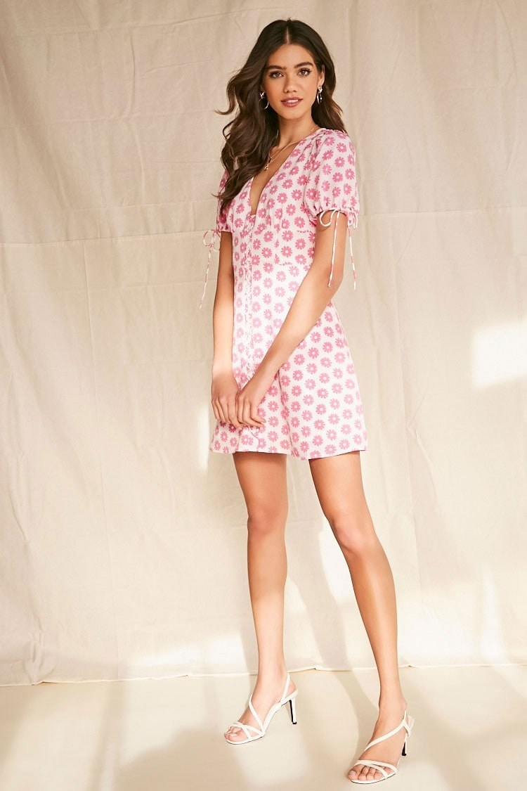 A mini dress with pink flowers and long ties at the sleeves