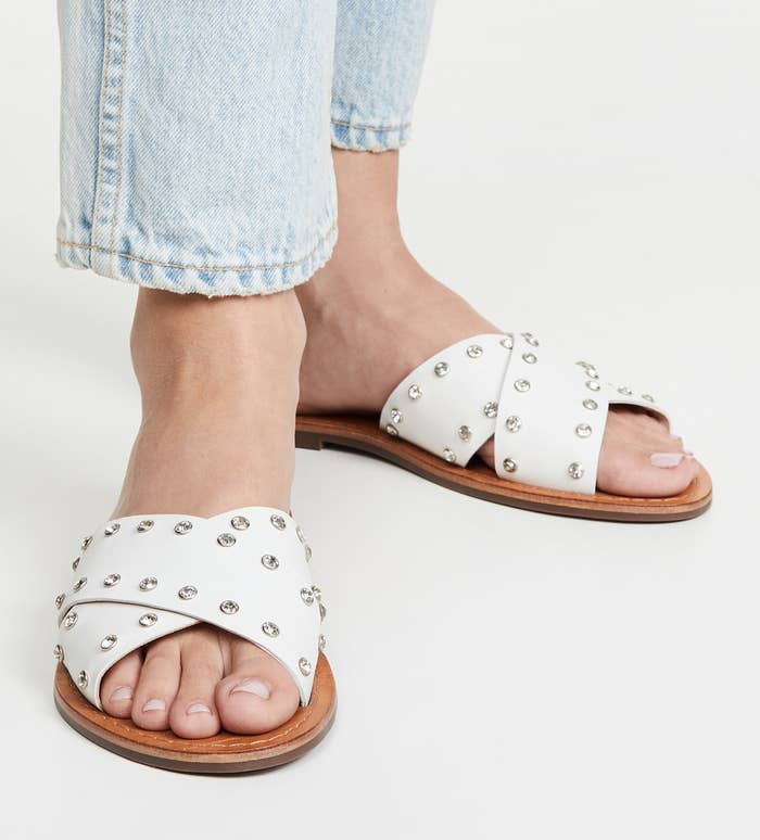 the white sandals with leather that criss-crosses over the foot, embellished with crystals