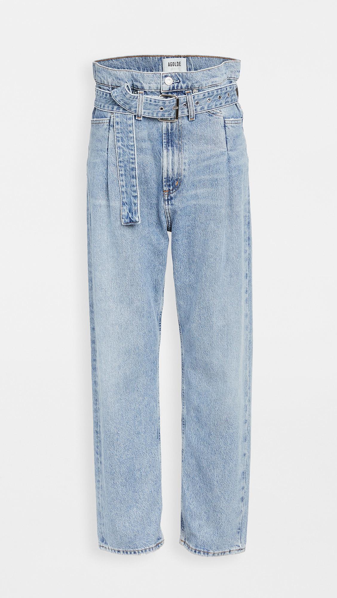 lightwash paper bag jeans with a thick denim belt