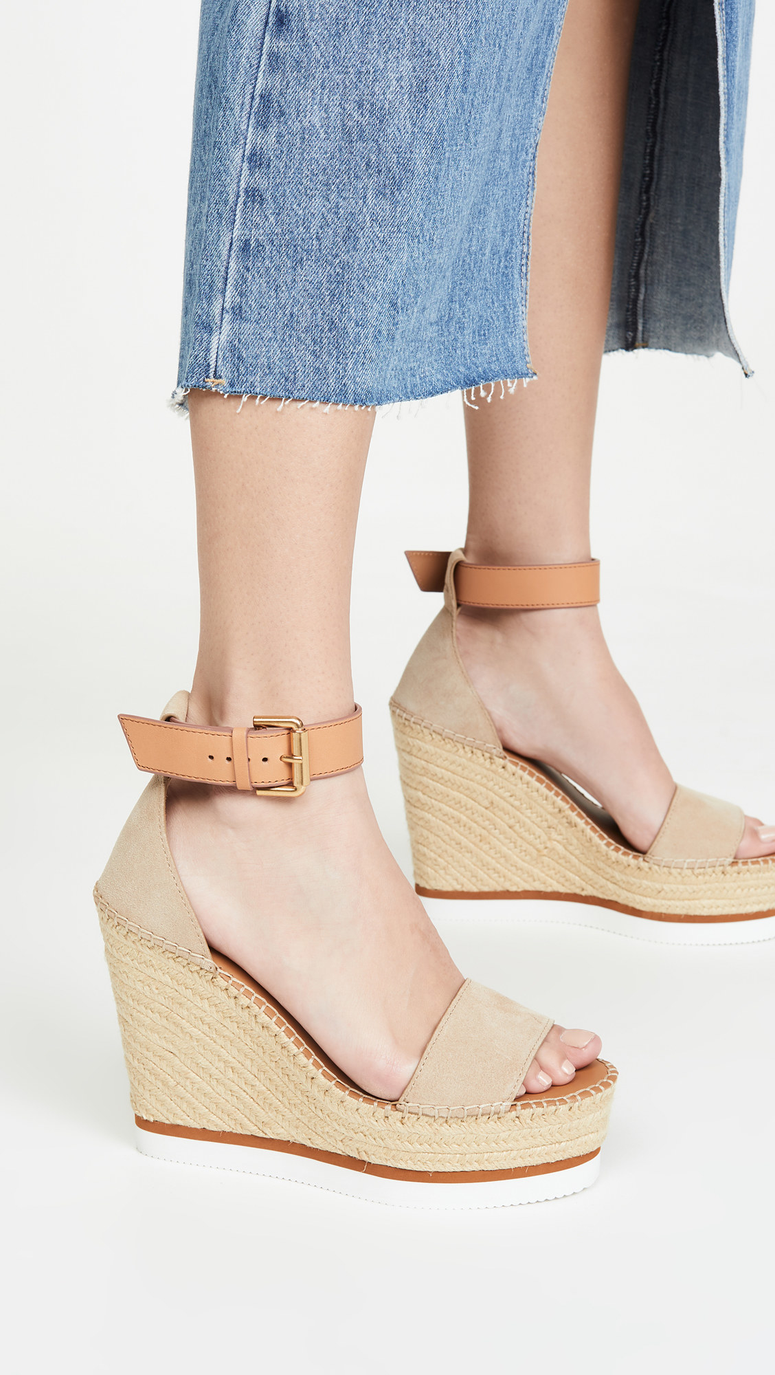 light tan espadrille wedges with a sporty foam sole and a slightly darker tan buckled closure at the top