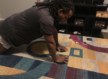 Reviewer uses the same core sliders while doing push-ups in their home