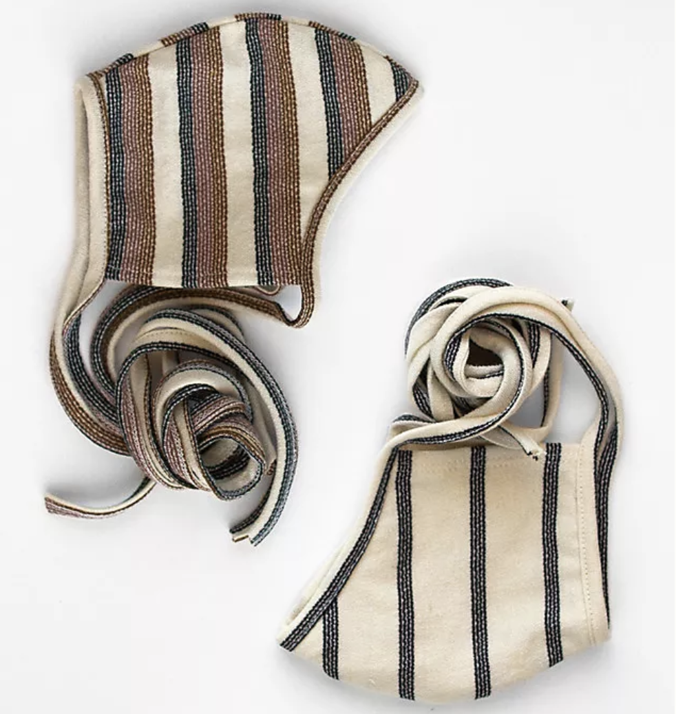 Two striped face masks in beige, navy, and brown tones