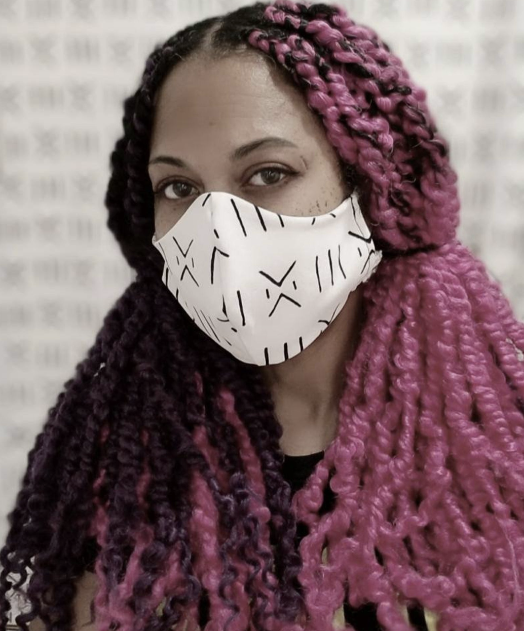 A model in a white and black patterned face mask
