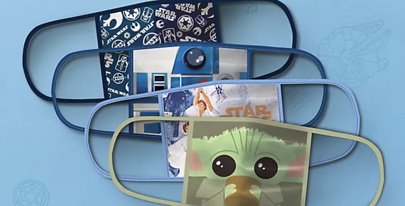 A set of Star Wars masks with Baby Yoda, Luke and Leia, R2-D2, and a Star Wars logo print