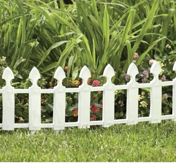 garden bed with short white picket fence style edging