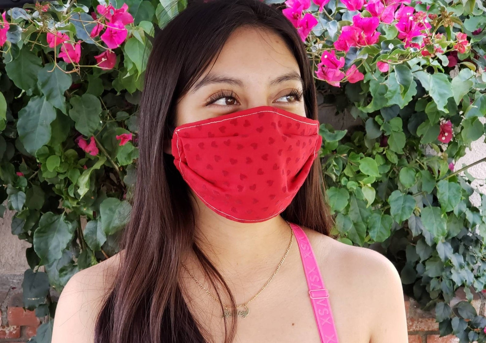 A model in a red heart-printed face mask