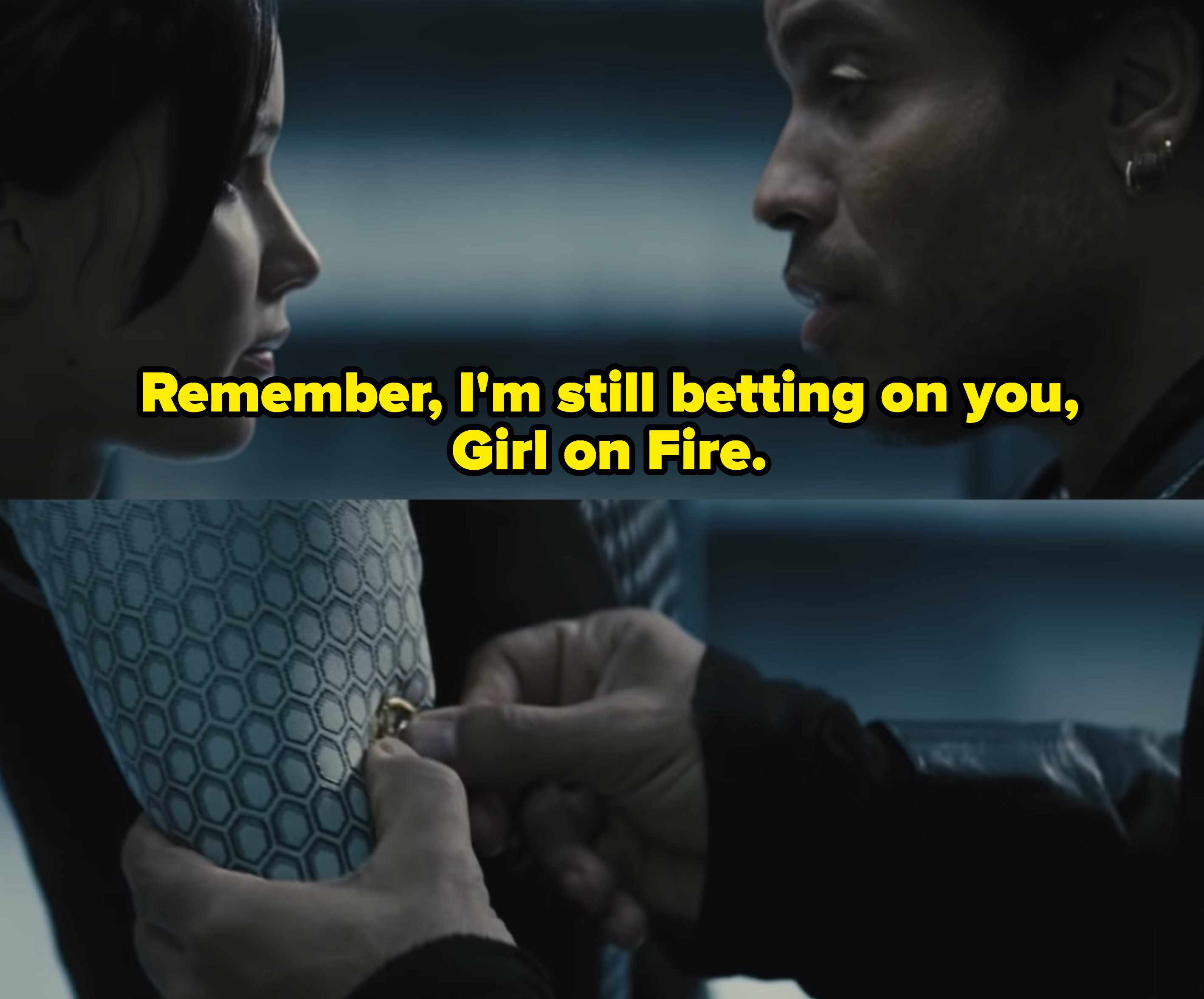 "Cinna telling Katniss, ""Remember I'm still betting on you, Girl on Fire,"" as he places a mockingjay pin on her sleeve."