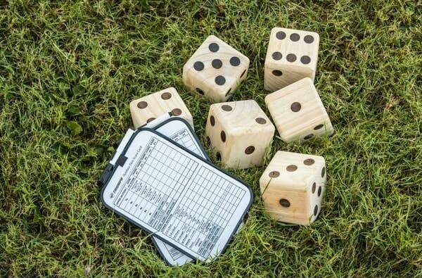 large wooden dice and dry-erase scoreboards