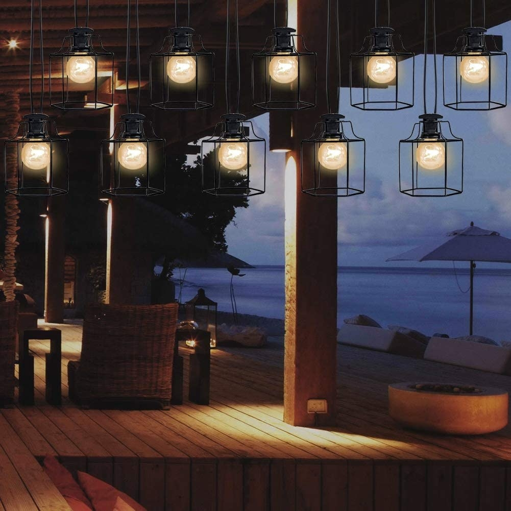 Hanging metal lanterns illuminate an outdoor area