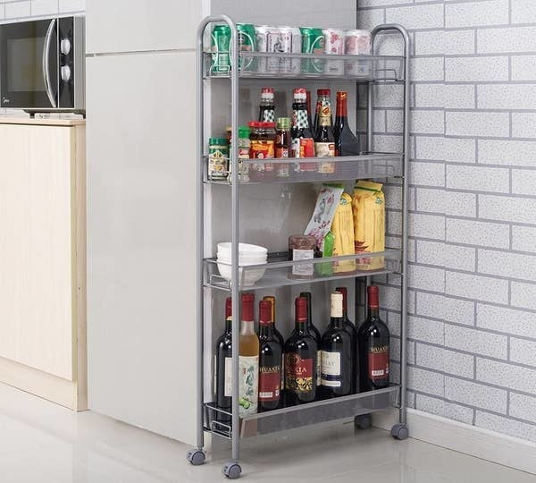 bar cart holding numerous bottles of wine, cans of soda, beers, and more