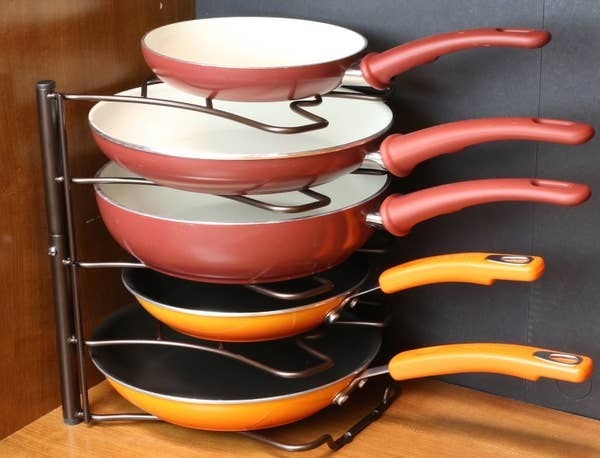 pan rack inside a cabinet holding various sized pans