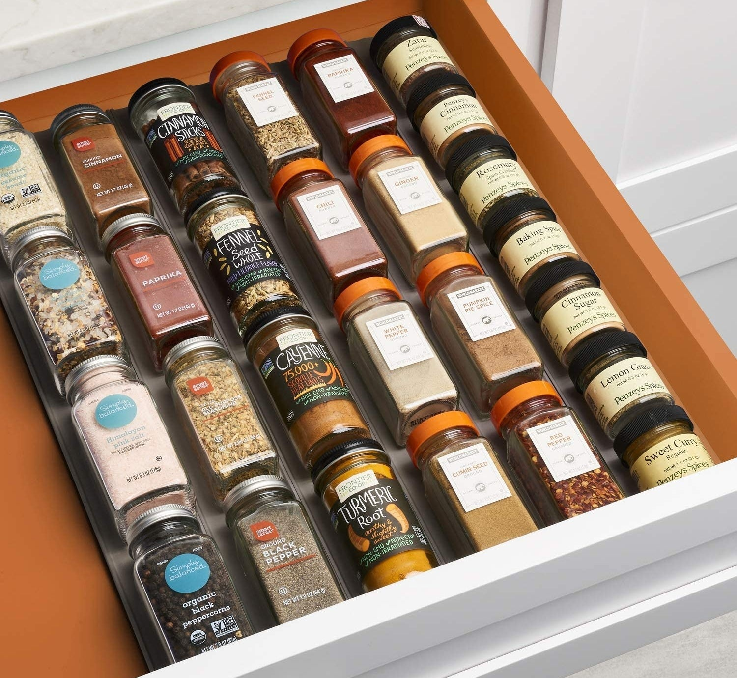 organizer inside of a drawer with various spices neatly aligned