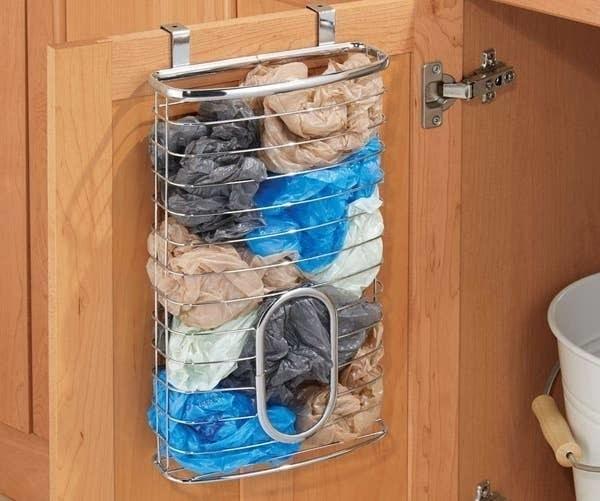 bag holder over cabinet holding bags