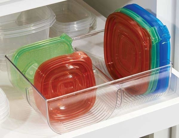 clear lid organizer holding various sizes of container lids