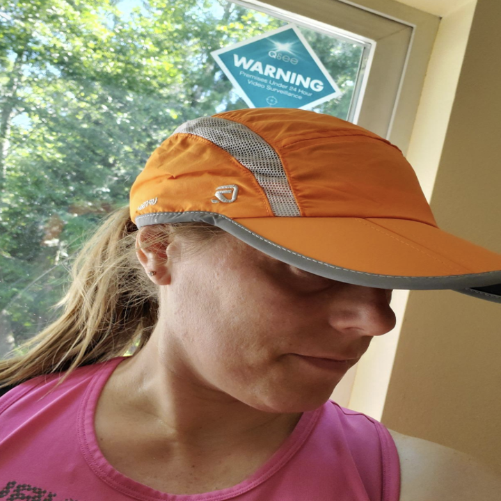 A reviewer in the orange hat