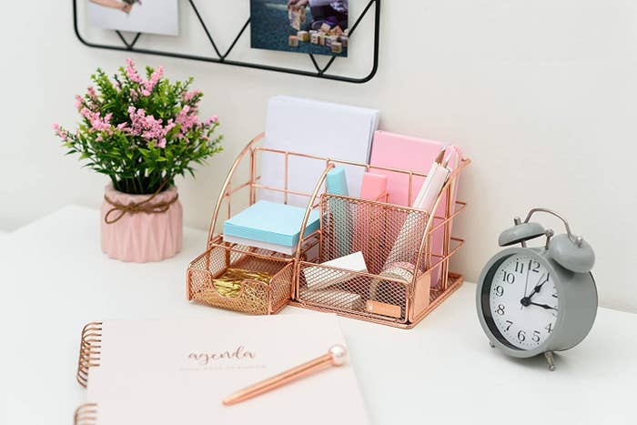 Desk organizer with pen and pencil holder, paper holder, small drawer, and three other compartments