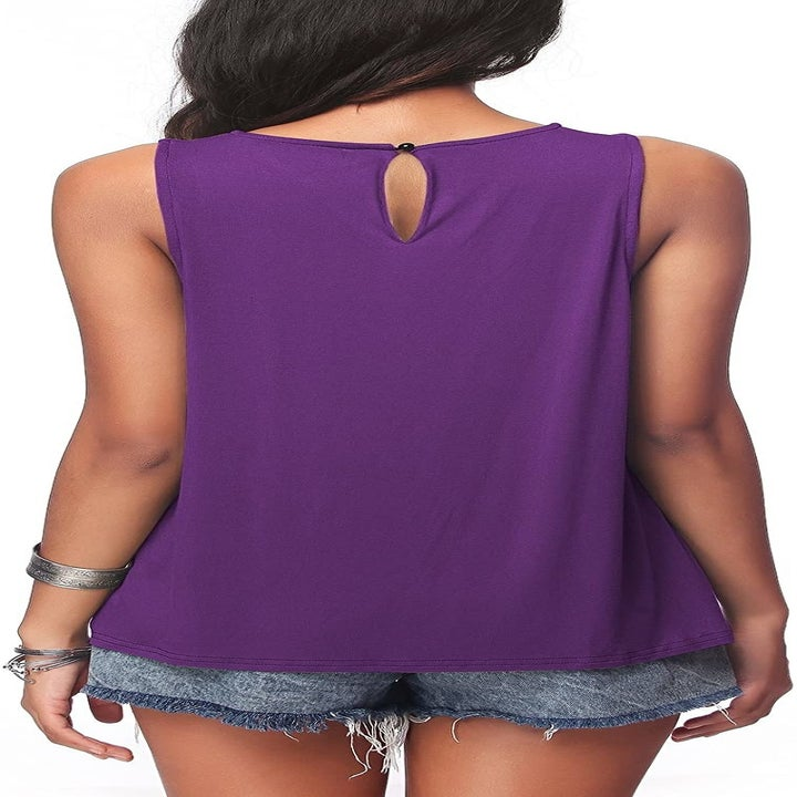 A model wearing the tank in purple, shown from the back, which has a little keyhole button detail