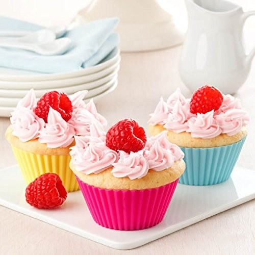 Reusable silicone cupcake moulds pictured with cupcakes.