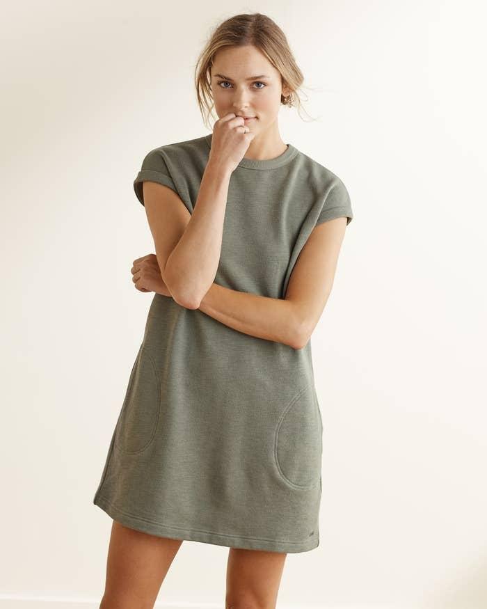 model wears the short sleeve dress in olive