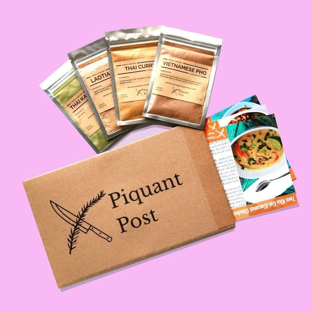 four packages of spaces and recipe cards coming out of an envelope. the top recipe says vietnamese pho