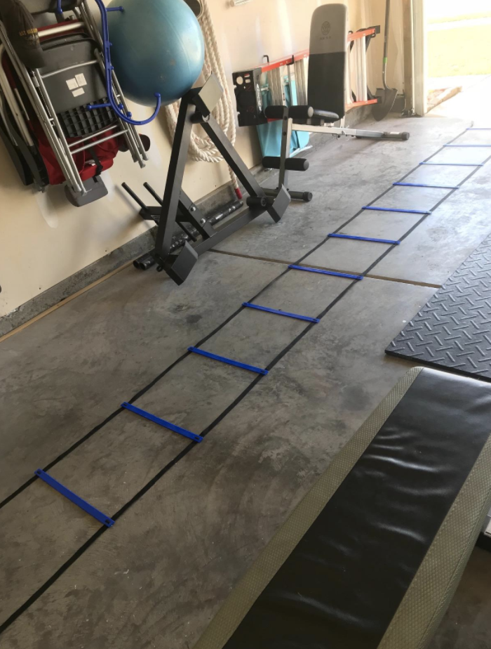 Reviewer places black agility ladder in their garage