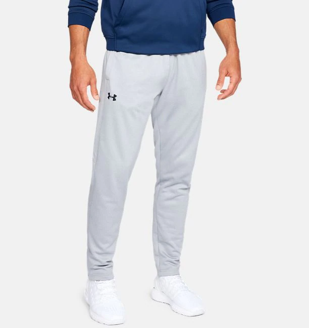 Model wearing a light gray pair of fitted sweatpants