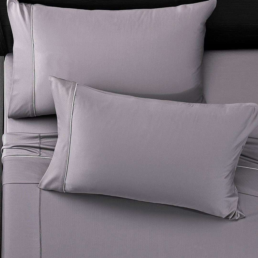 the sheets and pillowcases in gray