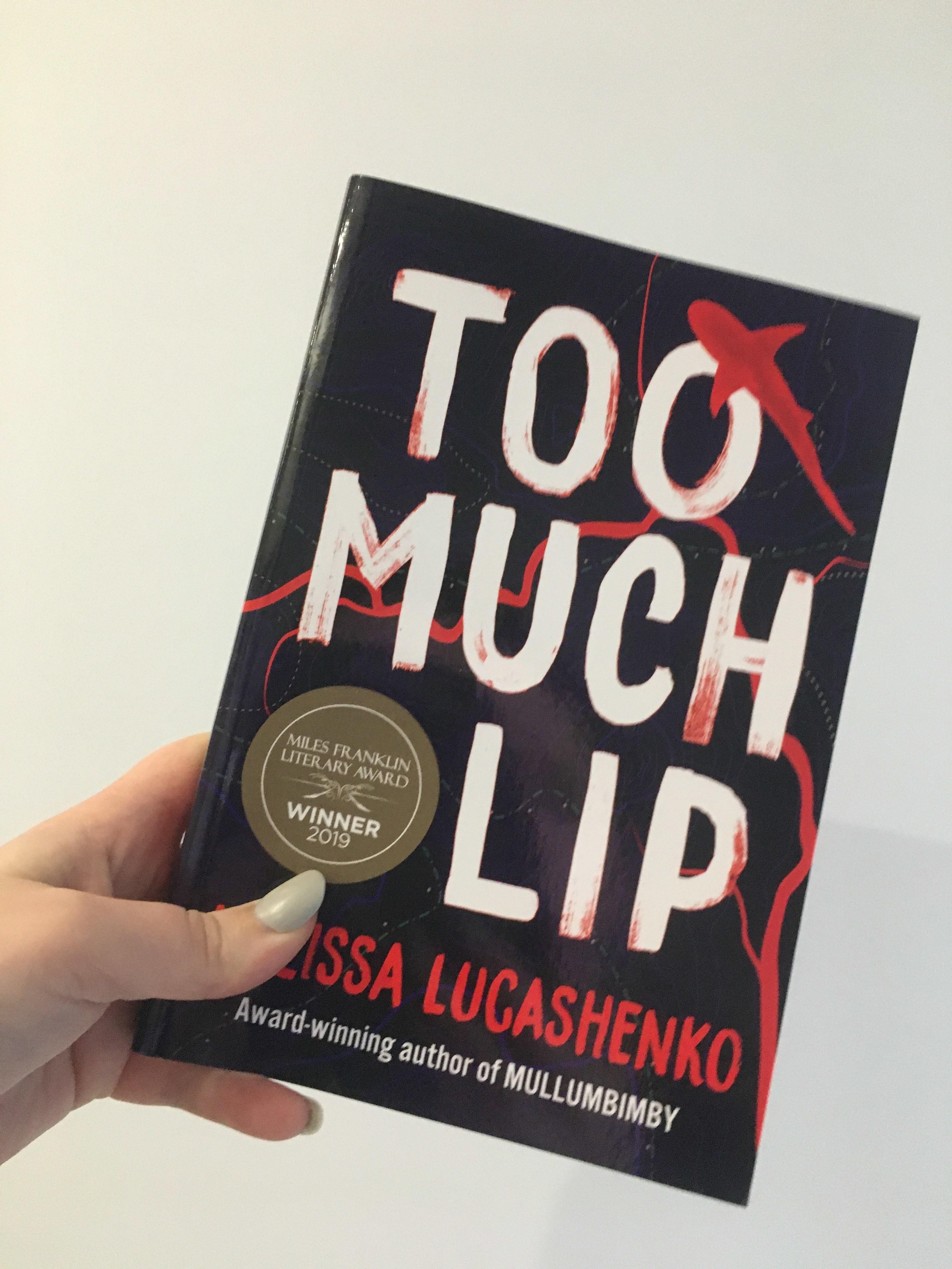 "Book cover featuring small cartoon shark and ""Miles Franklin Literary Award Winner 2019"" sticker."