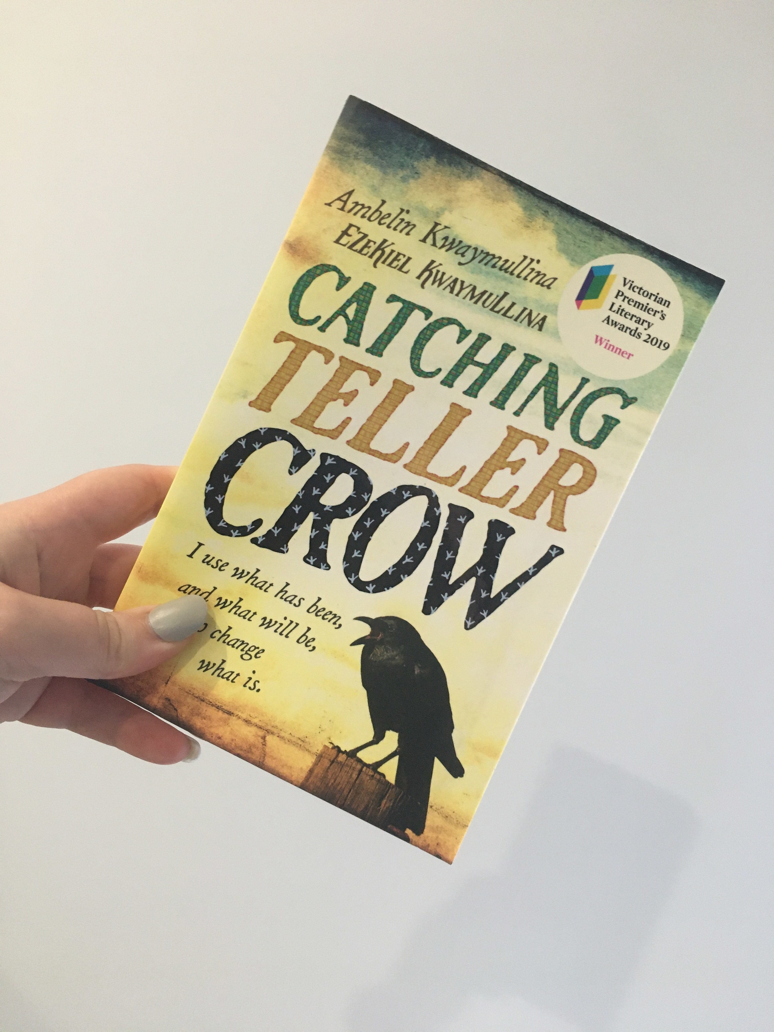 Book cover, drawing of a crow sitting on a wooden fence