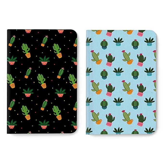 Black and blue journals with cacti print on them.