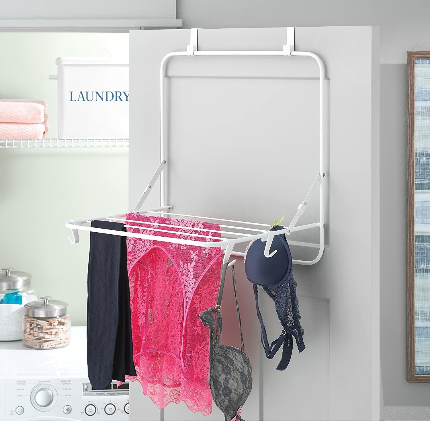 Bras, nighties, and yoga pants hanging from the over-the-door drying rack