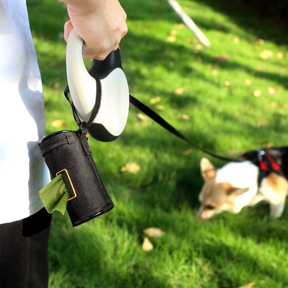 The poop bag holder attached to a leash