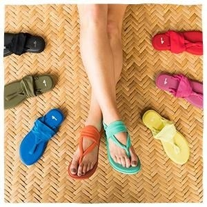 A model wearing different colored Sanuk sling sandals