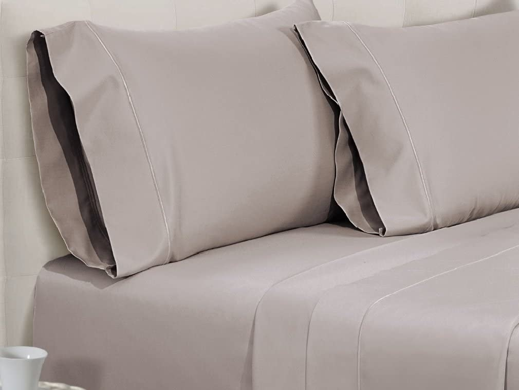 the sheets on a bed in taupe