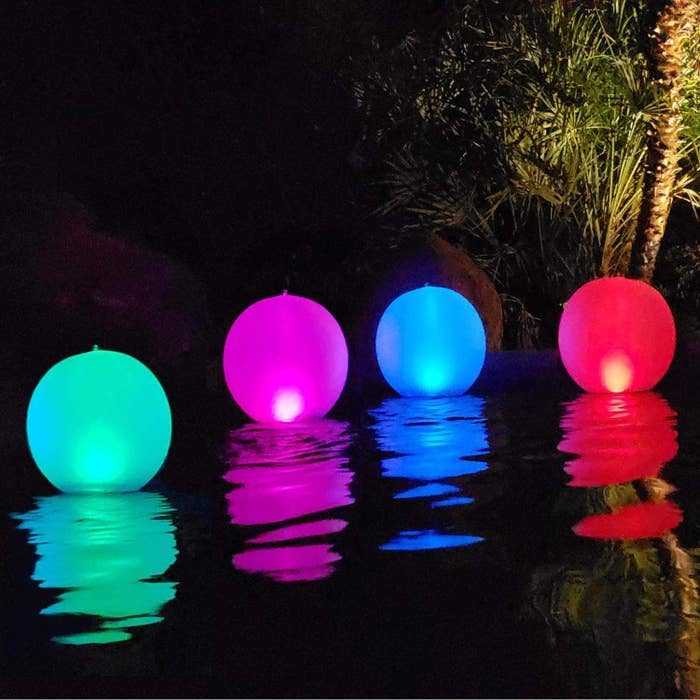 Four different-colored balls floating in the pool