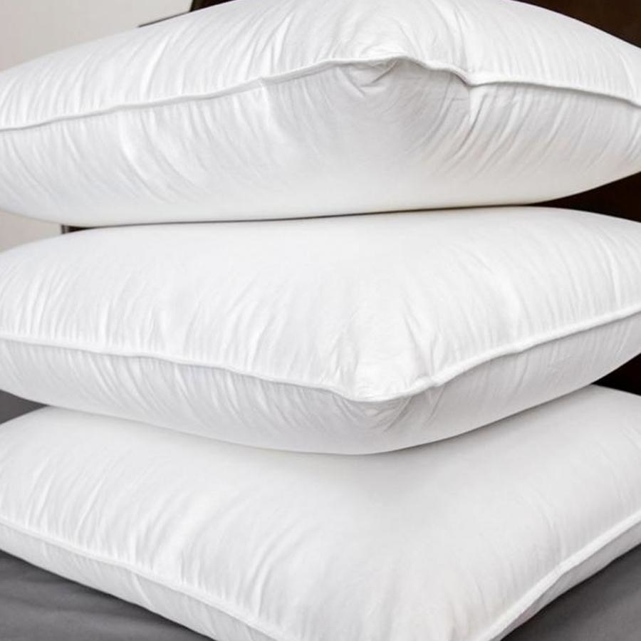 stack of three down pillows