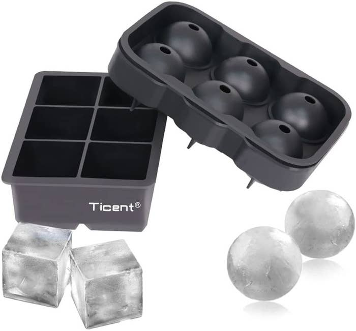 Two sets if jumbo ice cube molds — one spherical and one square — with frozen cubes.