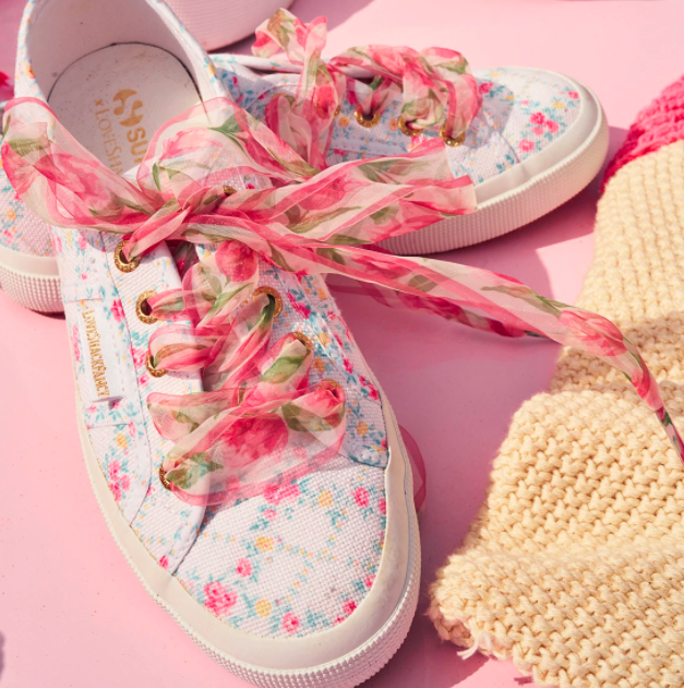 A pair of floral print Superga x LoveShackFancy sneakers.
