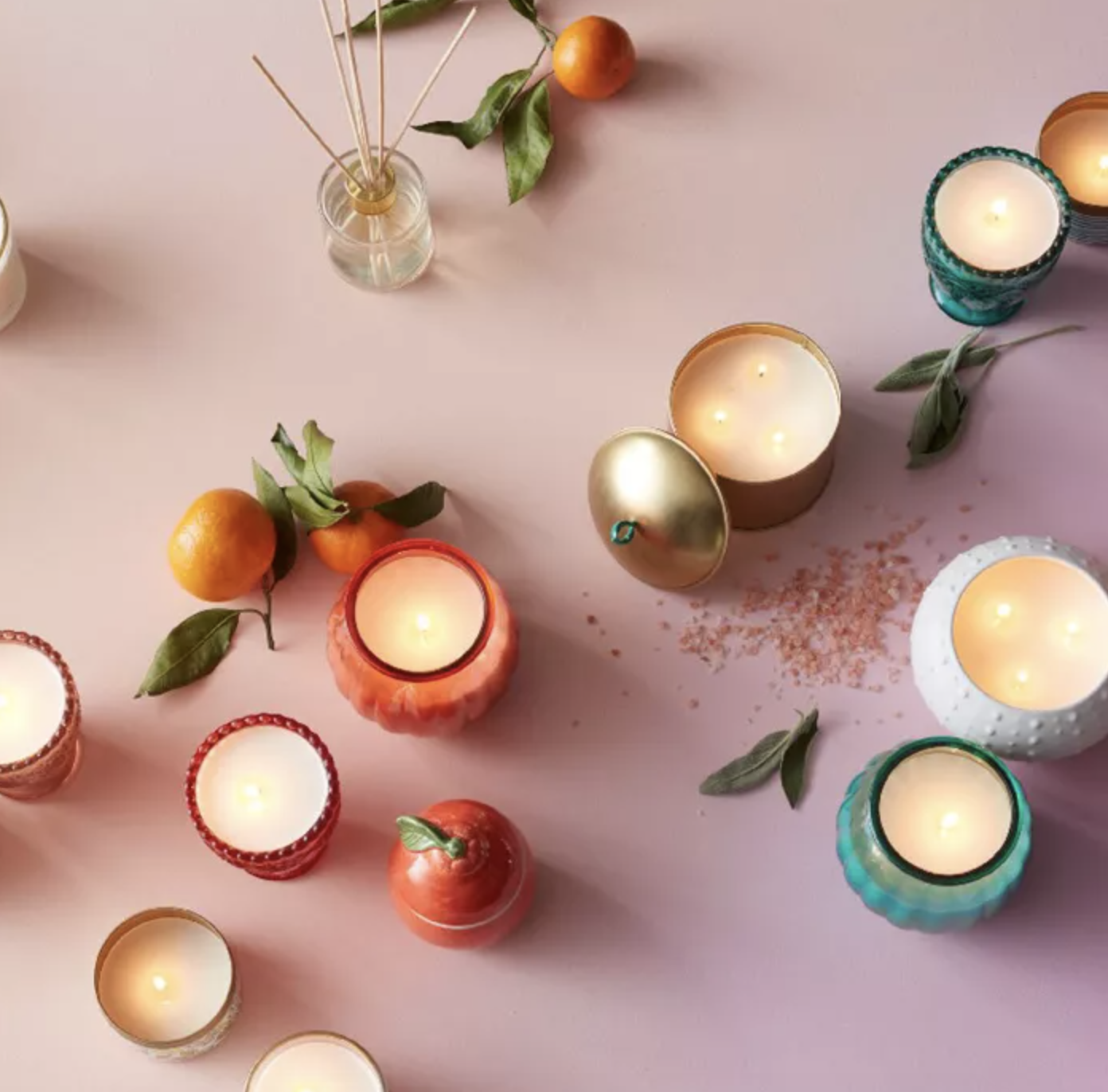 A bird's eye shot of a collection of candles from Target in a variety of colors and styles