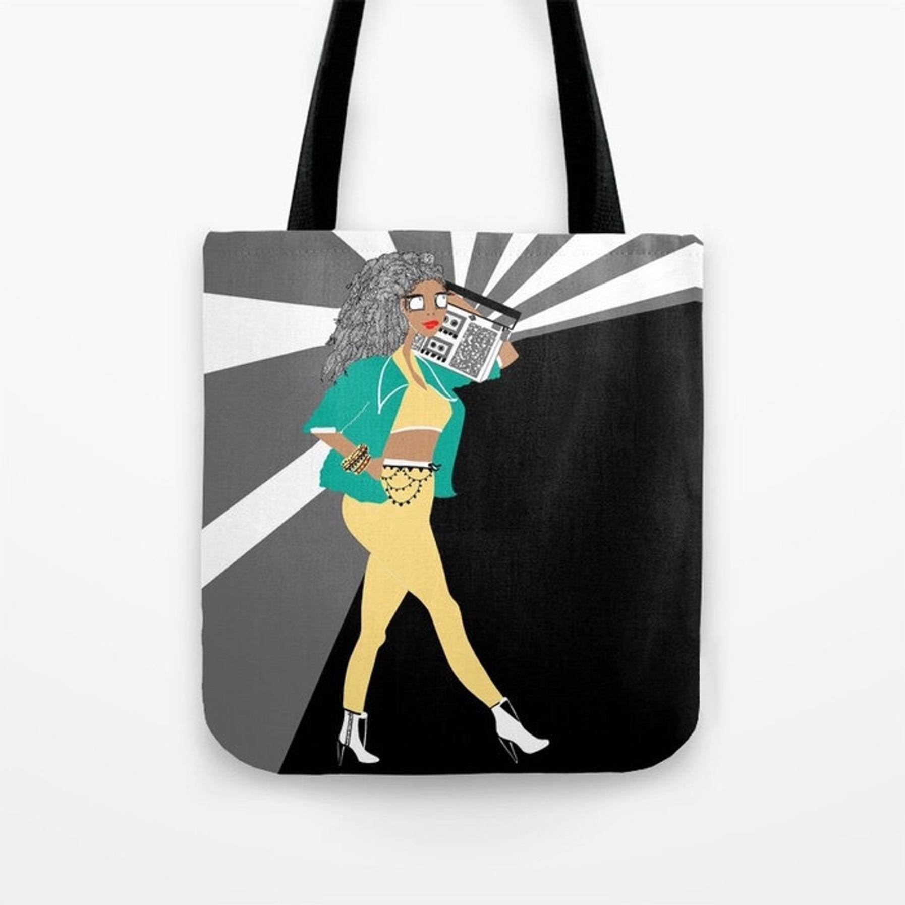The tote with an illustration of a woman walking with a boombox on her shoulder
