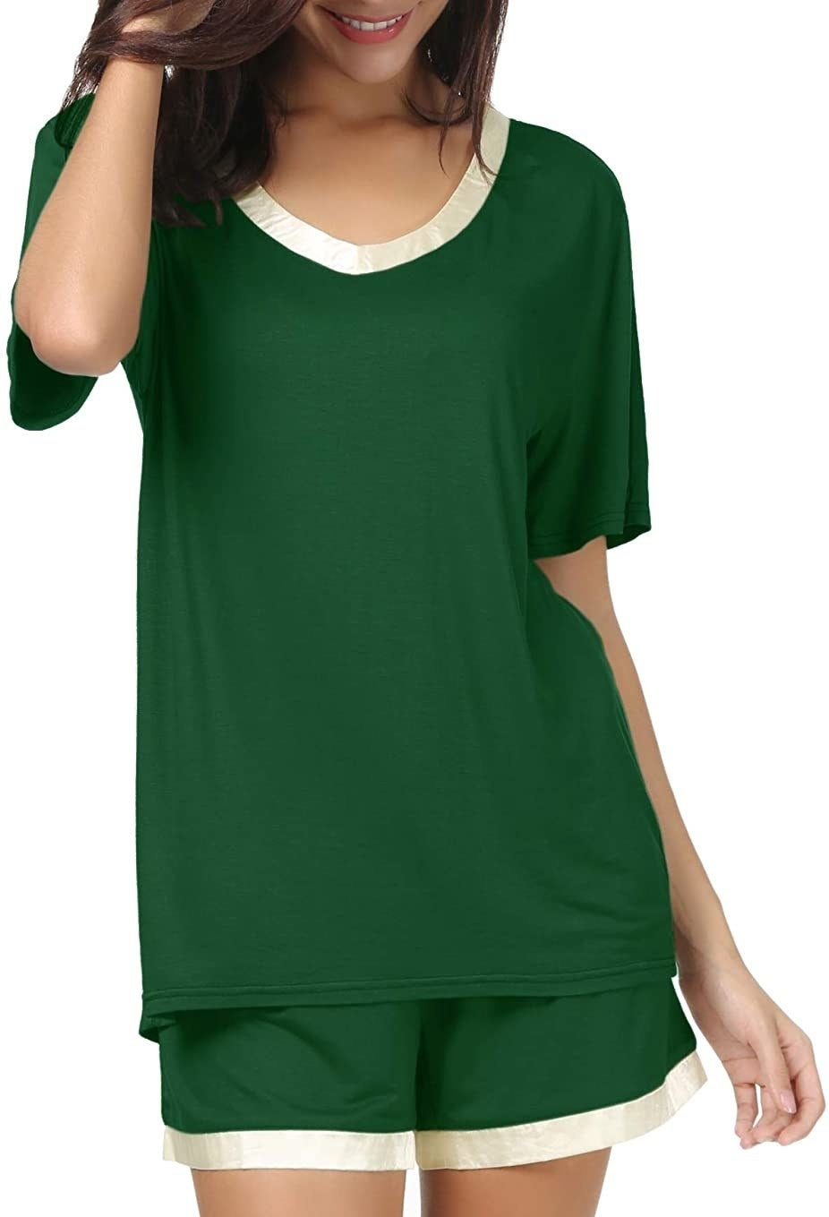 model in green scoop neck tee and shorts set with white satiny trim