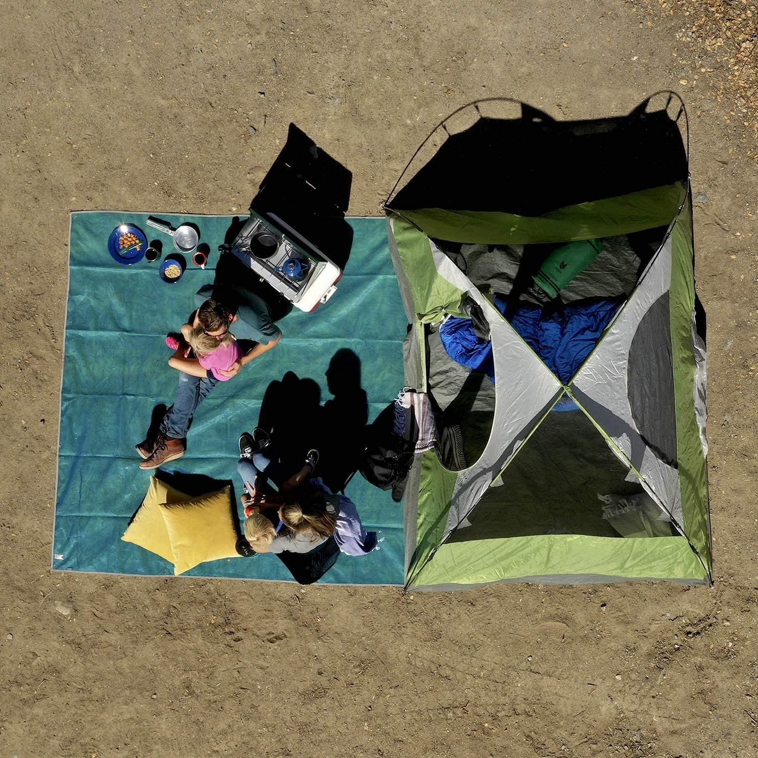 Overhead shot of the mat with two people sitting on it and plenty of room for their stuff