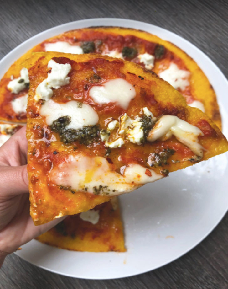 Butternut squash pizza with cheese and pesto.