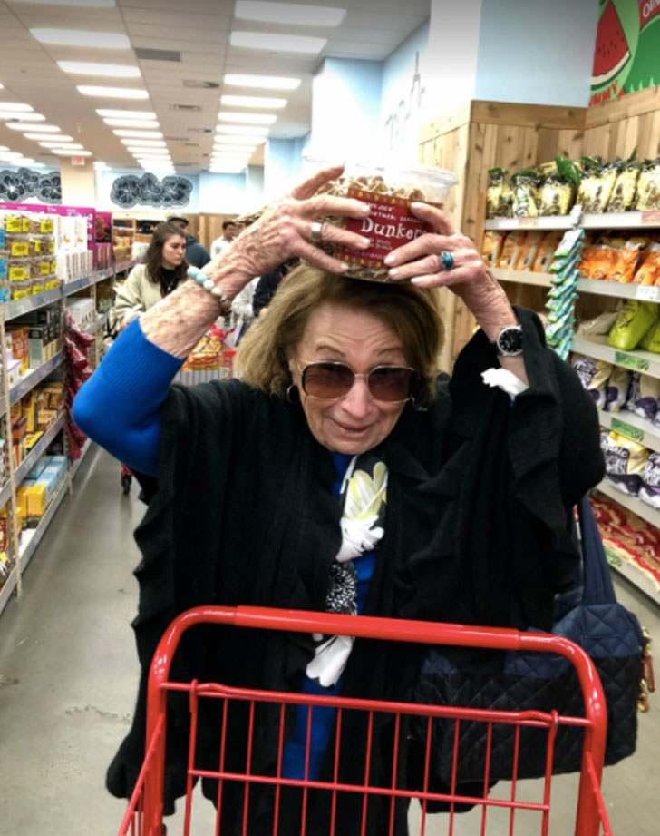 "My grandmother at Trader Joe's, showing off a package of ""dunkers"" cookies."