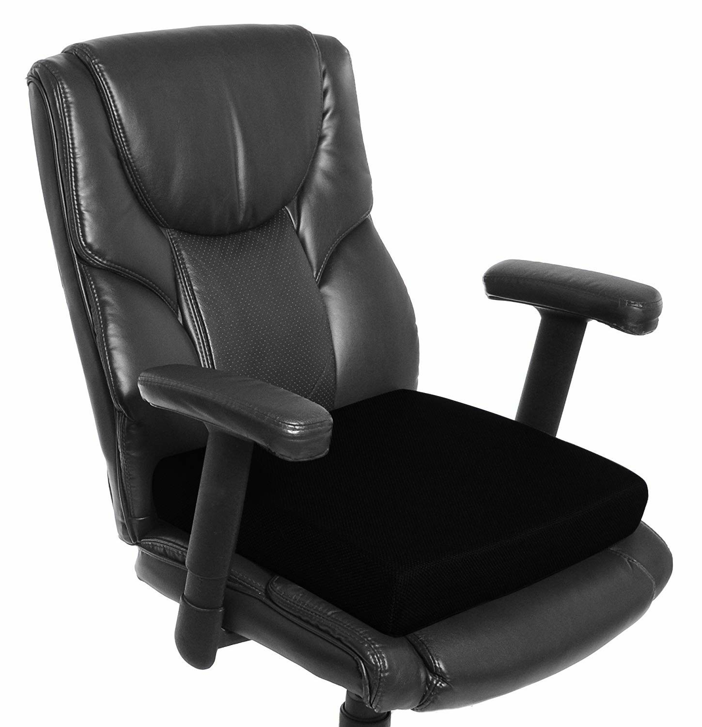 A black orthopaedic seat cushion on a computer chair