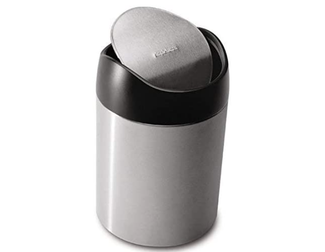 Small silver trash can with center-weighted swing lid