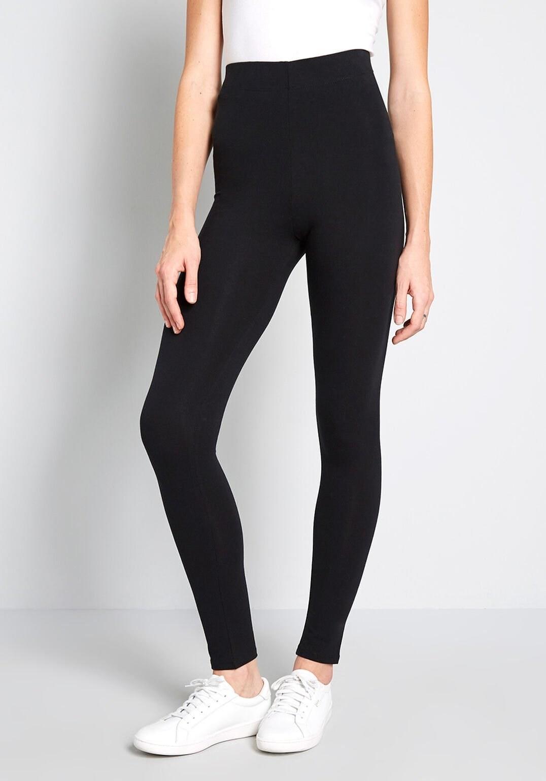 a model wearing the black high-waisted leggings