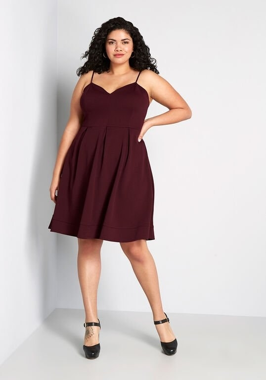 a model in the burgundy A-line dress