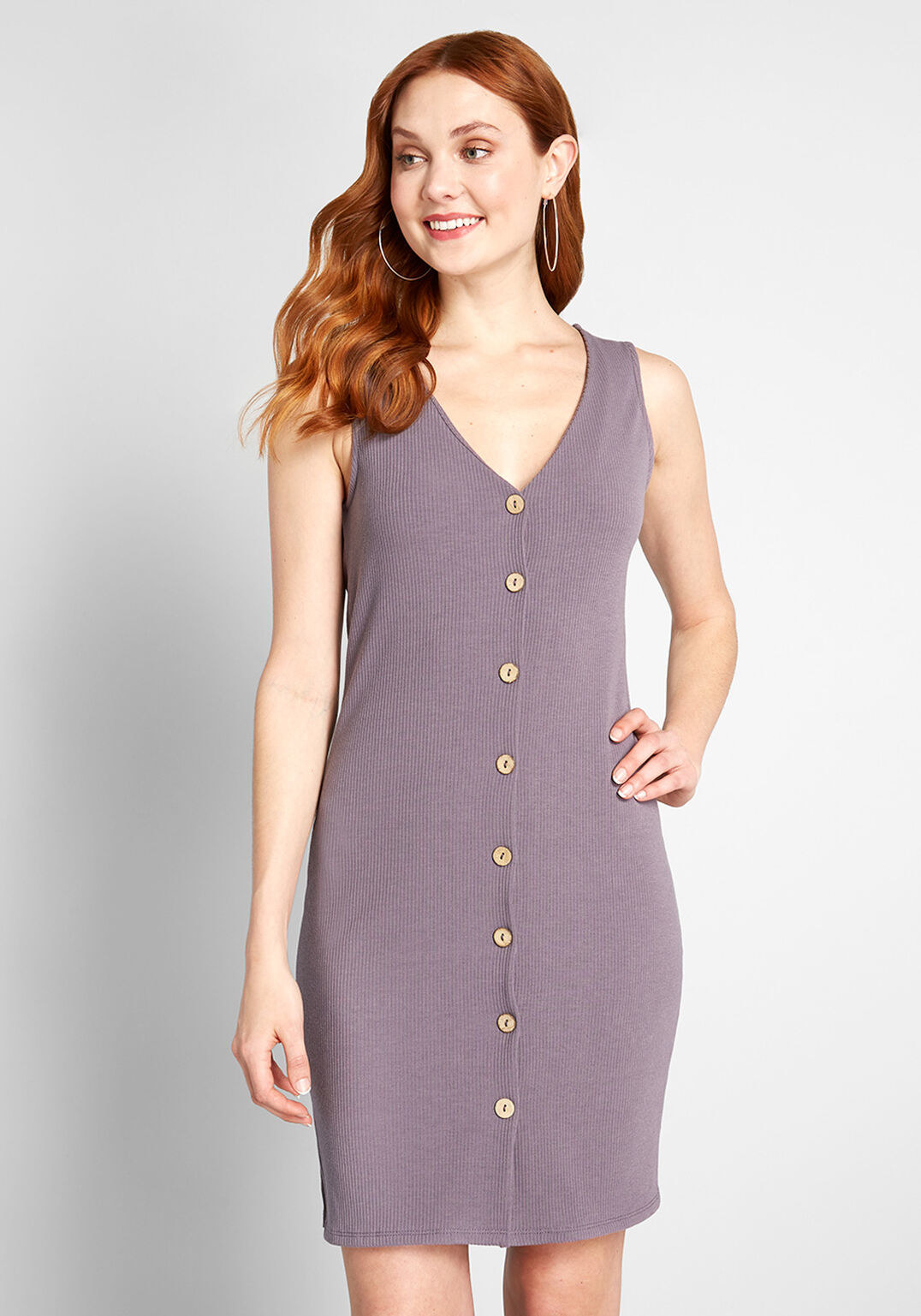 a model in a body hugging lilac ribbed dress that ends slightly above the knee